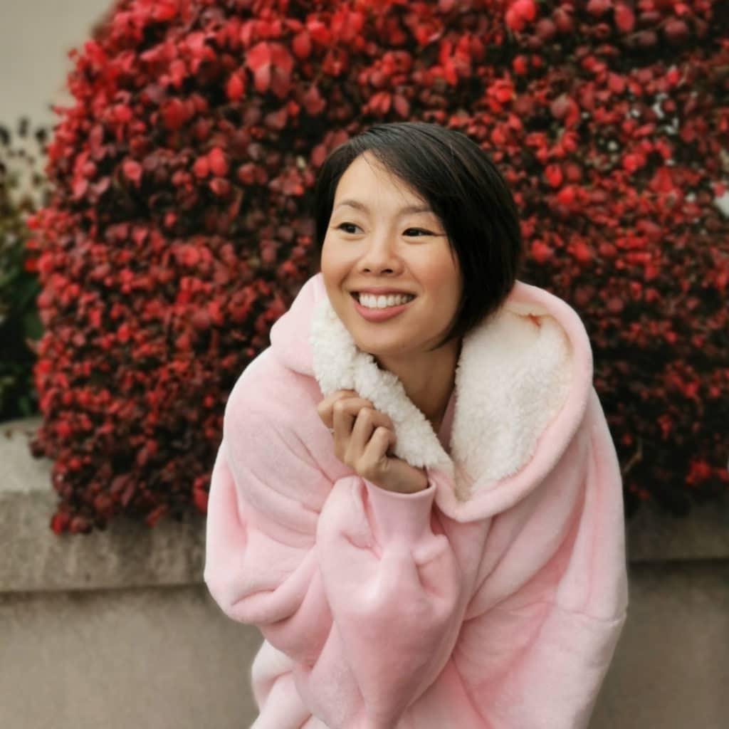 Smiling Girl in pink kuddly Blanket